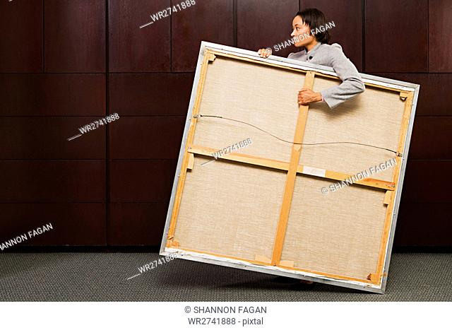 Business woman carrying canvas