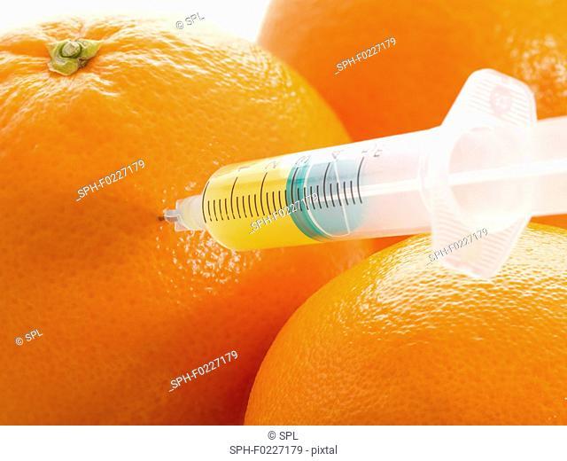Oranges with syringe