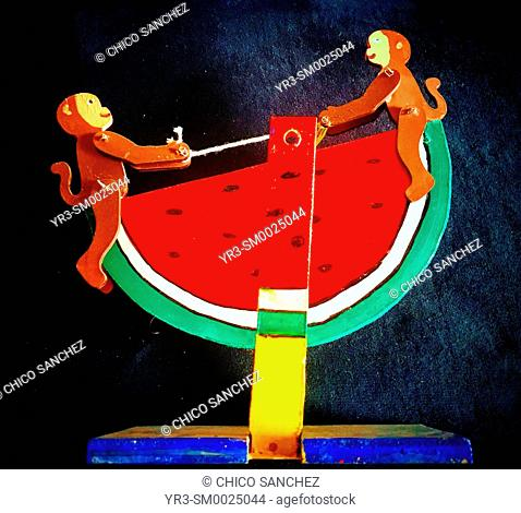 A toy of two monkeys riding a slice of watermelon decorates Taller Tlamaxcalli cardboard workshop in Colonia Roma, Mexico City, Mexico