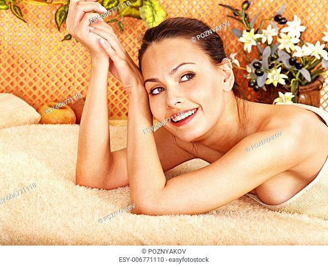Woman getting body mask in tropical beauty spa