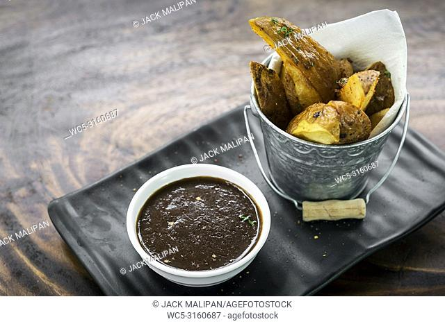 gourmet fried potato wedges with gravy sauce bar snack food