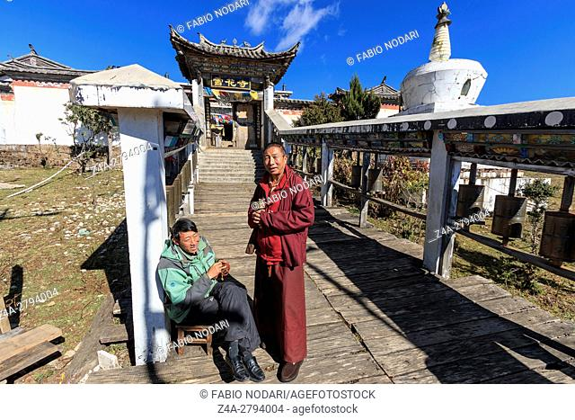 Lijiang, China: Tibetan Monk and guard in front of a Tibetan Temple in the Dragon Jade Snow Mountain in Yunnan, China