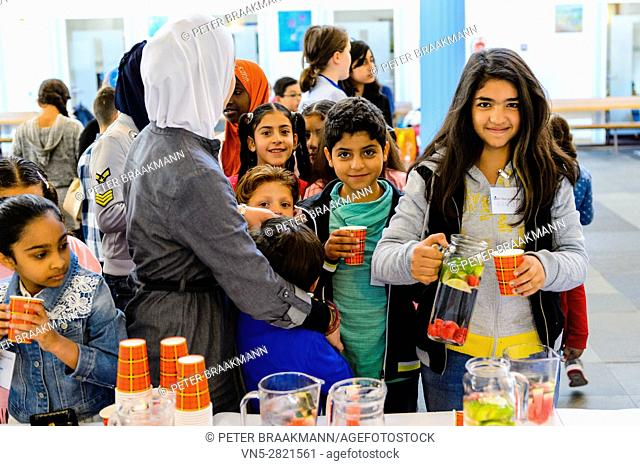 AALSMEER - THE NETHERLANDS - OCTOBER 8: Mayor children welcome refugees children on the national day of children mayors on October 8, 2016 in Aalsmeer