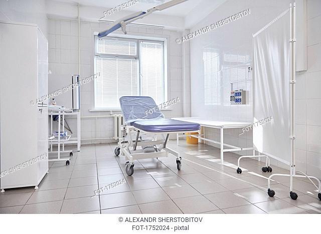 Hospital gurney by window in empty ward