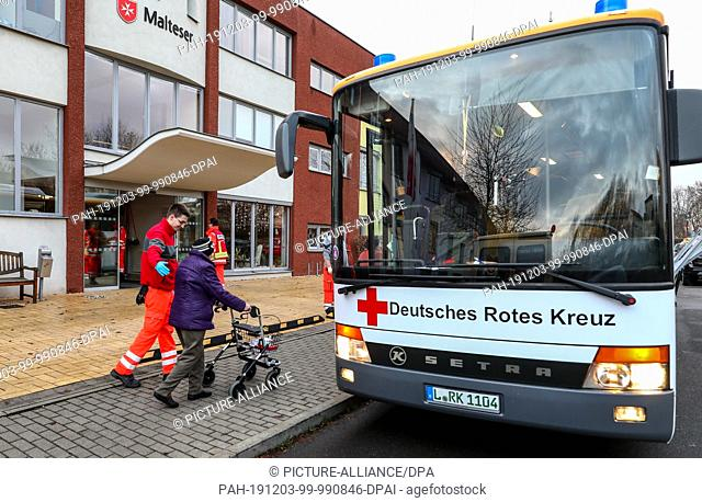 03 December 2019, Saxony, Leipzig: Residents of Malteser Abbey St. Mechthild leave their homes with the help of Red Cross staff after the discovery of an air...