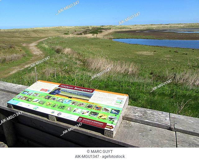 """Lookout and information sign at The """"Renvogelveld"""" on the northern tip of Wadden island of Texel, Netherlands. A man made wetland in the major migration..."""
