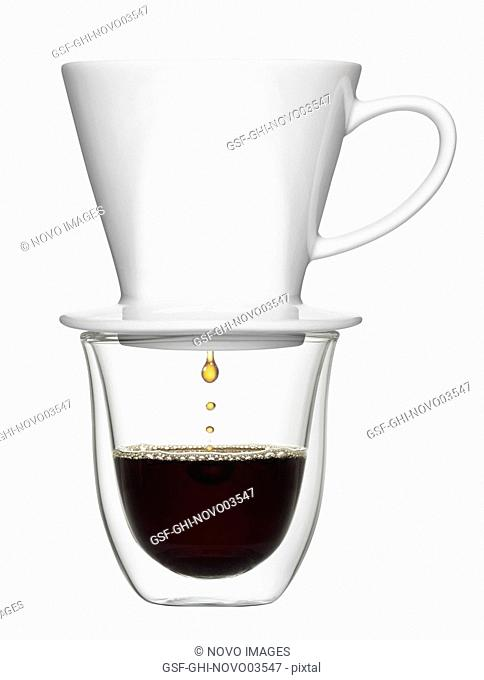 Coffee Dripping from Pour-over into Clear Cup