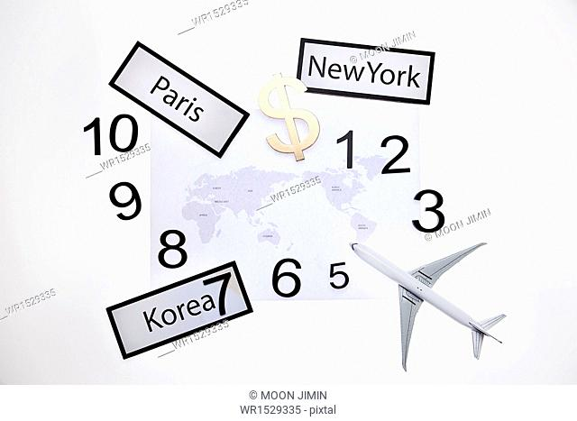 a world map surrounded by clock numbers