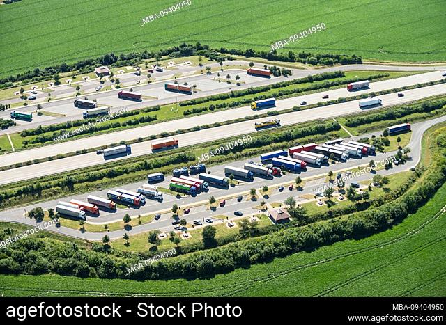 Aerial view of a highway rest stop by day
