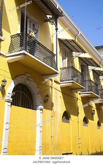 Panama, Panama City, Woman standing on balcony in Casco Viejo San Felipe