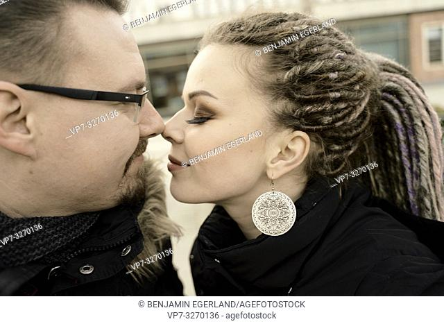 couple together in city, nose to nose, nudging noses, face to face, in Cottbus, Brandenburg, Germany