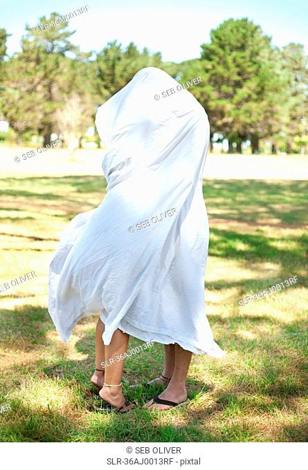 Couple wrapped in towel in park