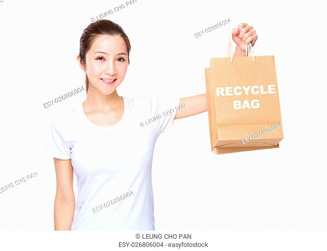 Woman carry with shopping bag and showing phrase of recycyle bag