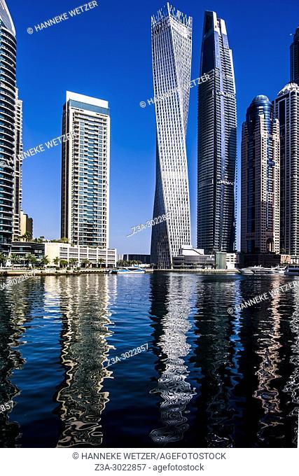 Abstract water reflection of supertall skyscrapers at Dubai Marina, Dubai, UAE
