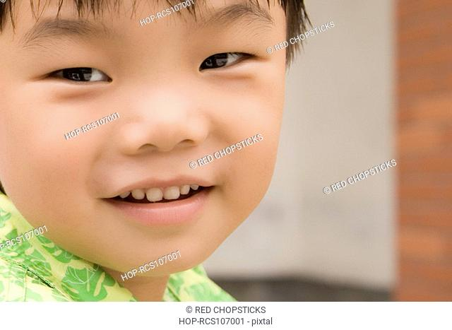 Close-up of a boy smiling