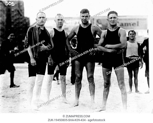 Aug. 5, 1945 - New York, NY, U.S. - JACK DEMPSEY (C) with friends at beach. Jack 'Manassa Mauler' Dempsey (June 24, 1895 - May 31