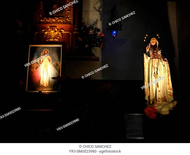 The images of Jesus Christ of Divine Mercy and the Virgin Mary decorate Saint Francis church in Queretaro, Mexico