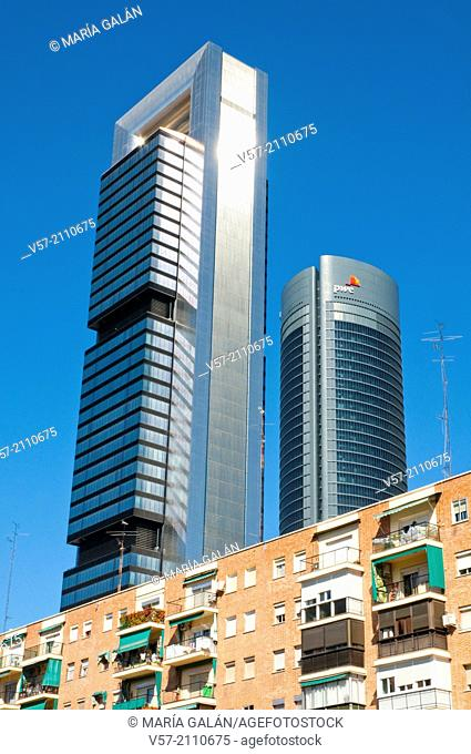 Two of the Four Towers contrasting with tenements. Madrid, Spain