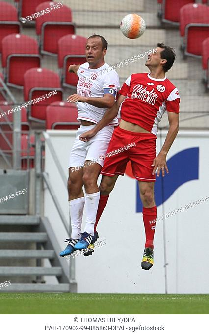 """Nikolce Noveski (l) and Manuel Friedrich in action during the FSV Mainz 05 vs """"""""Nikolce and friends"""""""" football match at the Opel Arena in Mainz, Germany"""
