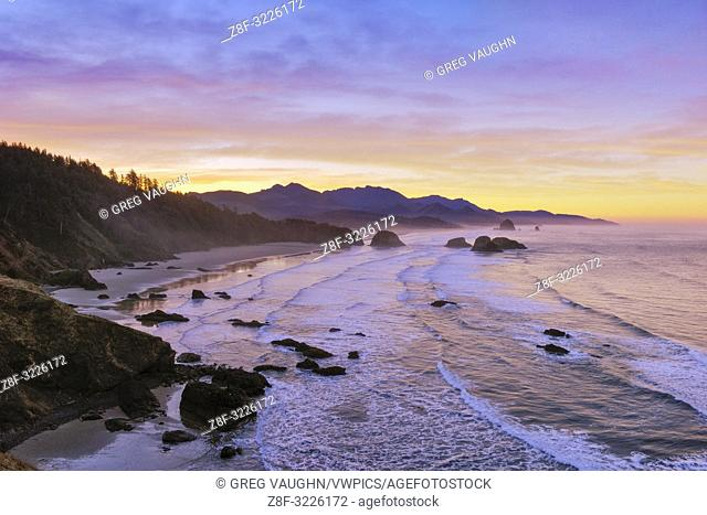 View of Crescent Beach, Cannon Beach, Haystack Rock and coast to Hug Point from Ecola State Park at sunrise; Oregon