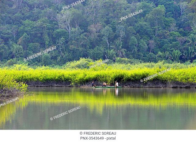 Rio Dulce flowing under a gorge surrounded by lush vegetation, Guatemala, Central America