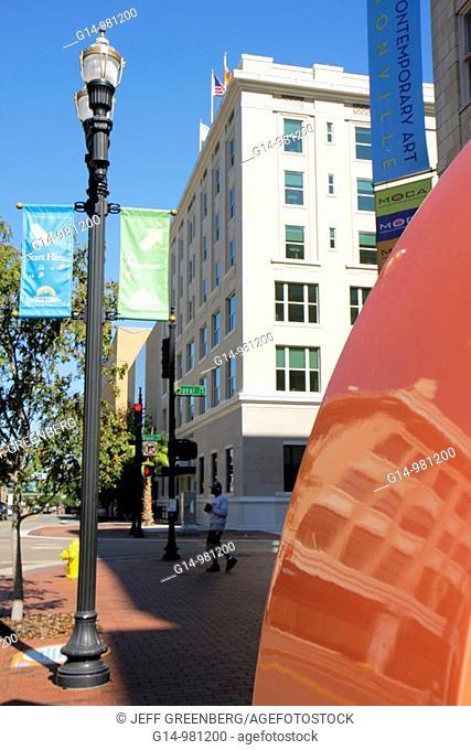 Florida, Jacksonville, Laura Street, MOCA, Museum of Contemporary Art, sidewalk, partial reflection on sculpture, street lamp