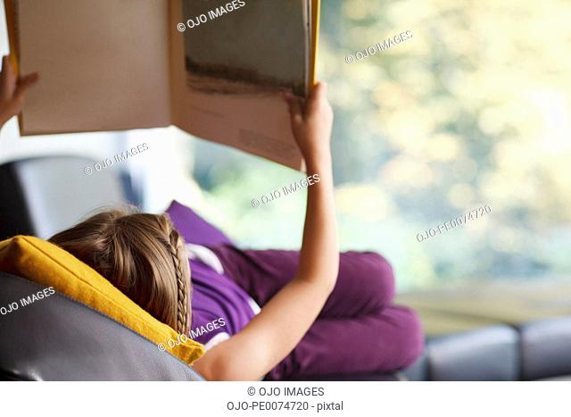 Girl laying down reading book