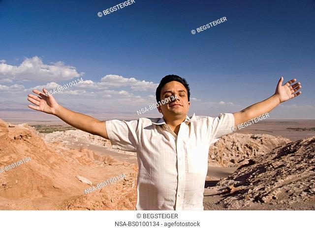 young man enjoying Atacama Desert, Chile, South America