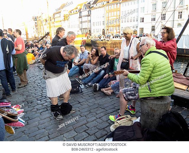 street buskers perform in the Nyhavn harbour area,Copenhagen,Denmark