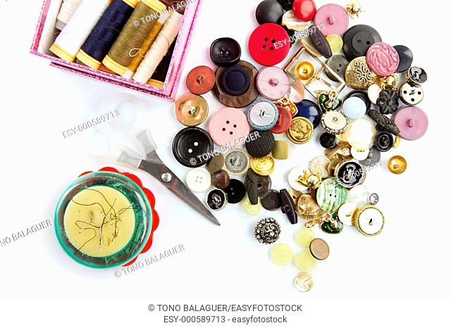 sewing stuff buttons nails thread scissors mixed still life on white