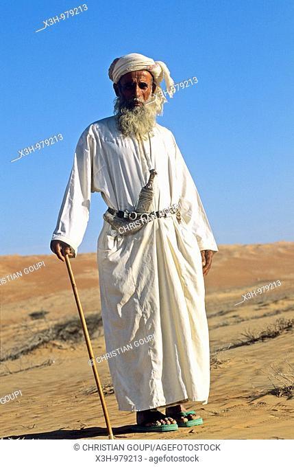 old bedouin man in Wahiba sands, Sultanate of Oman, Arabian Peninsula, southwest Asia