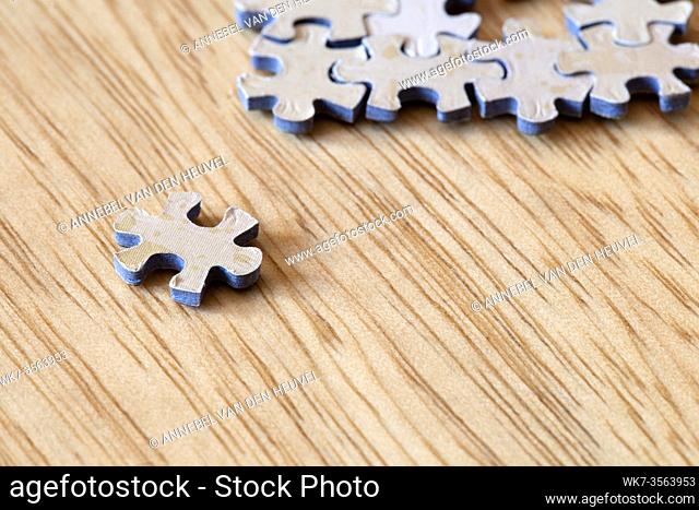 Blank puzzle pieces on wooden background texture, business and connection concept. space for text. modern design