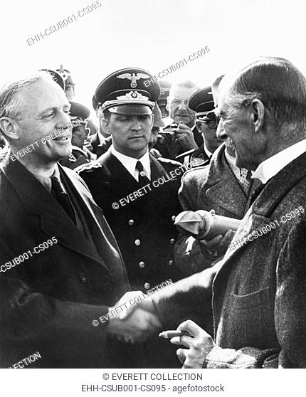 German Foreign Minister Von Rippentrop (left) shakes hands with Neville Chamberlain. The British Prime Minister arrived at Munich airport for his first...