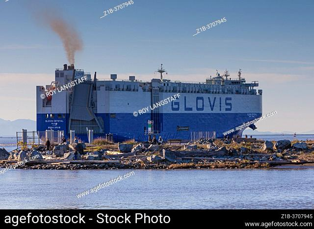 Glovis Crystal car transport ship departing the Fraser River in British Columbia Canada