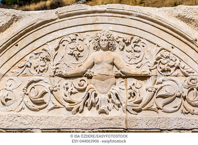 Marble reliefs in Ephesus historical ancient city, in Selcuk, Izmir, Turkey. Figure of Medusa with ornaments of Acanthus leaves, Detail of the Temple of Hadrian