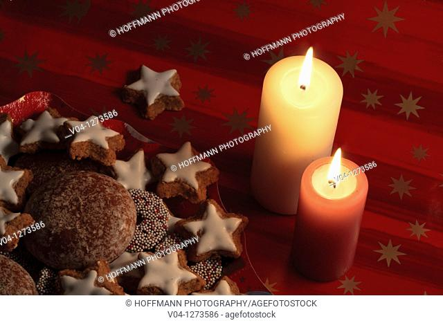 Lit candles and lots of christmas cookies