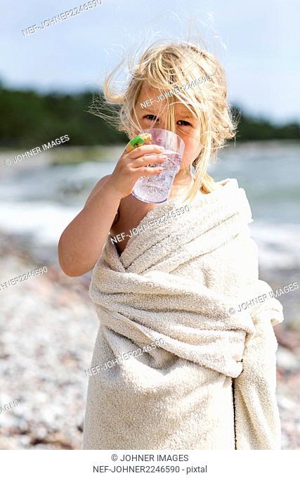 Girl drinking soda at lakeshore