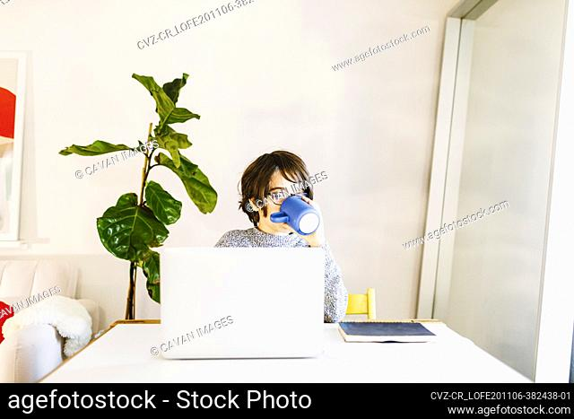 Child drinking milk during remote home schooling