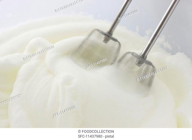 Egg whites being beaten