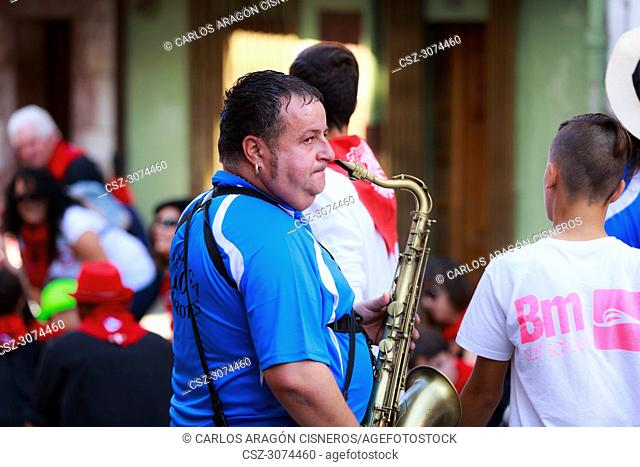 AMPUERO, SPAIN - SEPTEMBER 10: Unidentified musician with a saxophone before the Bull Run on the street during festival in Ampuero, celebrated on September 10