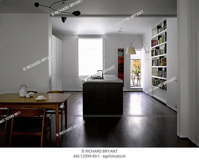 Open-plan kitchen and dining room with sliding doors, Bayswater, London, UK