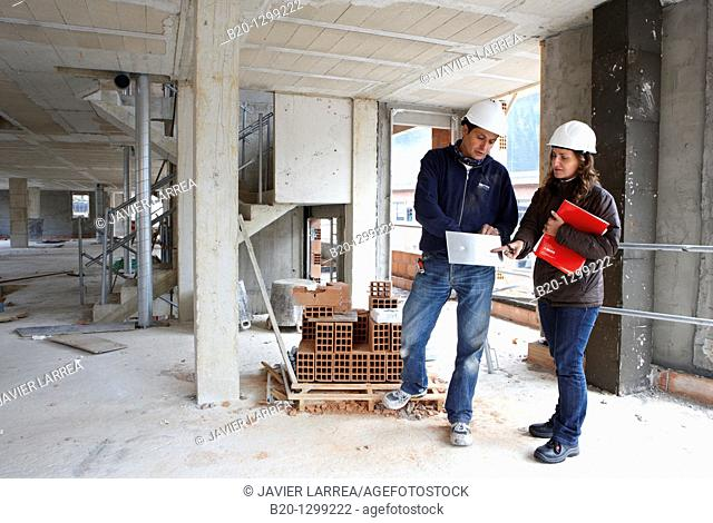 Worker and technician, new homes under construction, construction site