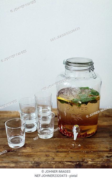 Glasses and jar with lemonade
