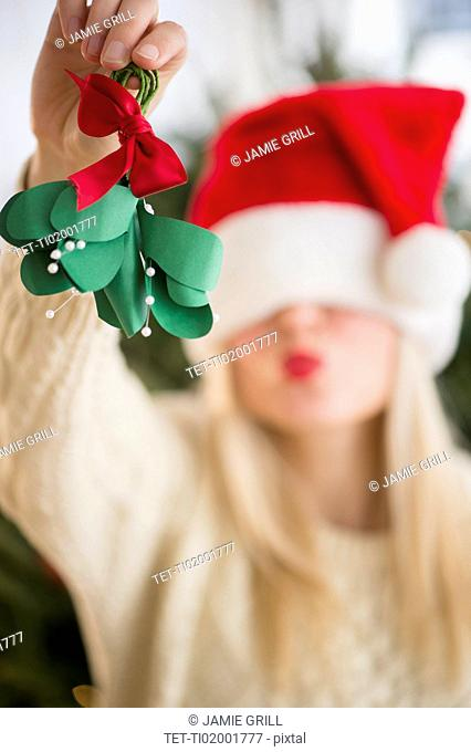 Woman colding christmas decoration