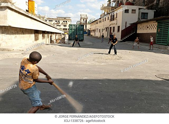 Boys playing baseball in the streets of La Habana, Cuba, Caribbean