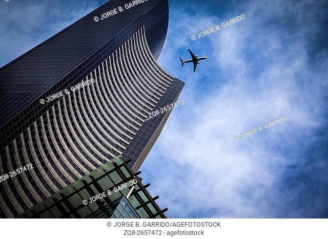 airplane with modern building in Seattle business district, Washington State