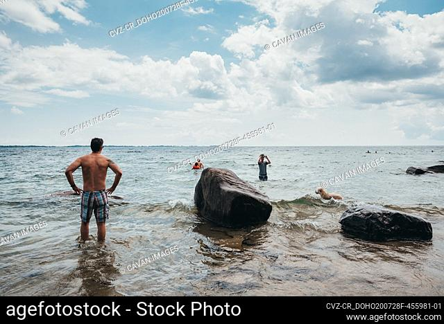 Family cooling off in water of Lake Ontario on a hot summer day
