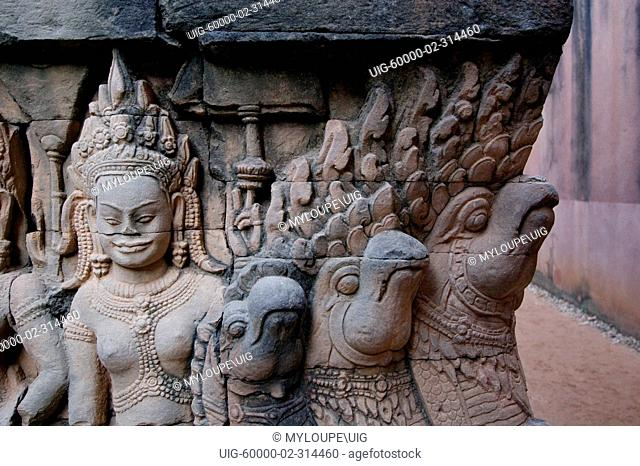 Sandstone bas relief of Devata & Nagas of the underworld on the hidden wall at the Leper King Terrace, part of the Royal Square of Angkor Thom - Angkor Wat
