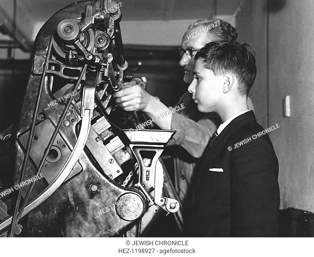 David Reiss inspects a linotype machine at the Jewish Chronicle, London, 4 January 1960. The world's oldest and most influential Jewish newspaper