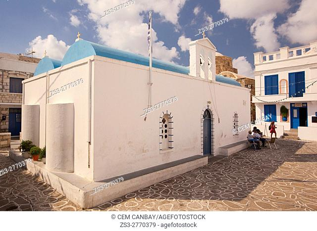 Locals sitting in front of the blue domed church in the town center Chora or Chorio, Kimolos, Cyclades Islands, Greek Islands, Greece, Europe
